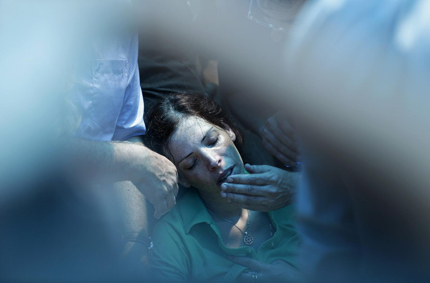 Dana, the sister of Israeli soldier Tsafrir Bar-Or, mourns during his funeral.