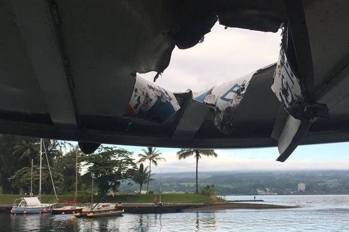 The hole through the boat's canopy.