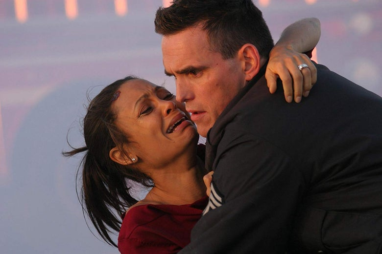 Thandie Newton sobs in Officer Matt Dillon's arms in Crash.