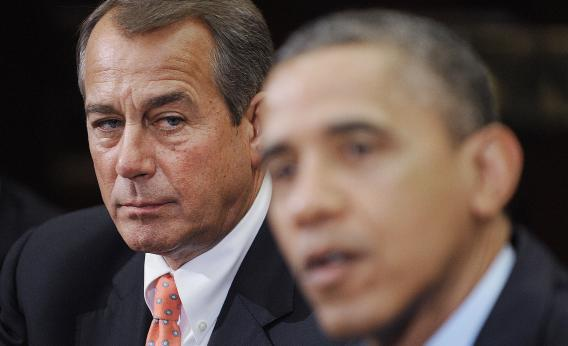 Speaker of the House John Boehner (R-OH), left, listens as U.S. President Obama speaks.