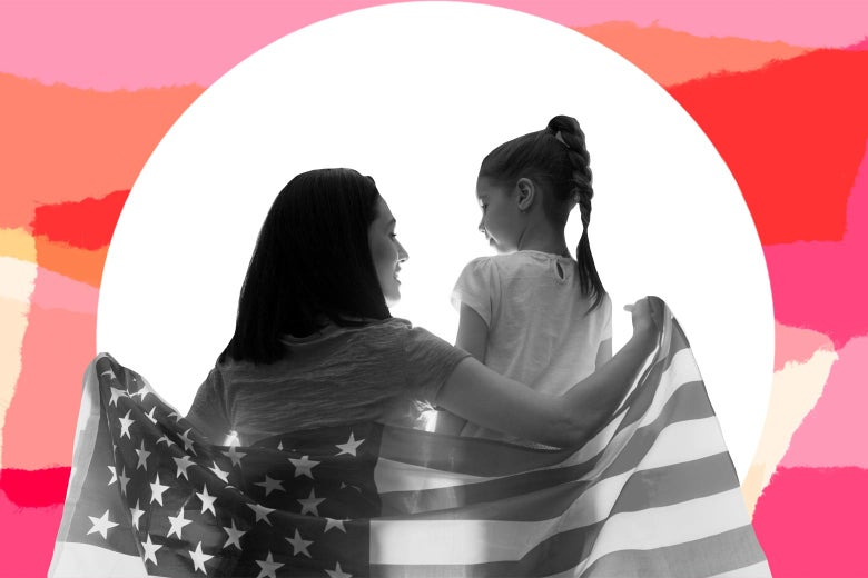 A woman wraps herself and a little girl within a U.S. flag.