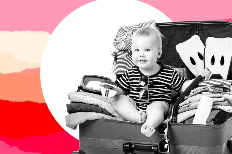 A baby sits in a suitcase with flippers and beach gear.