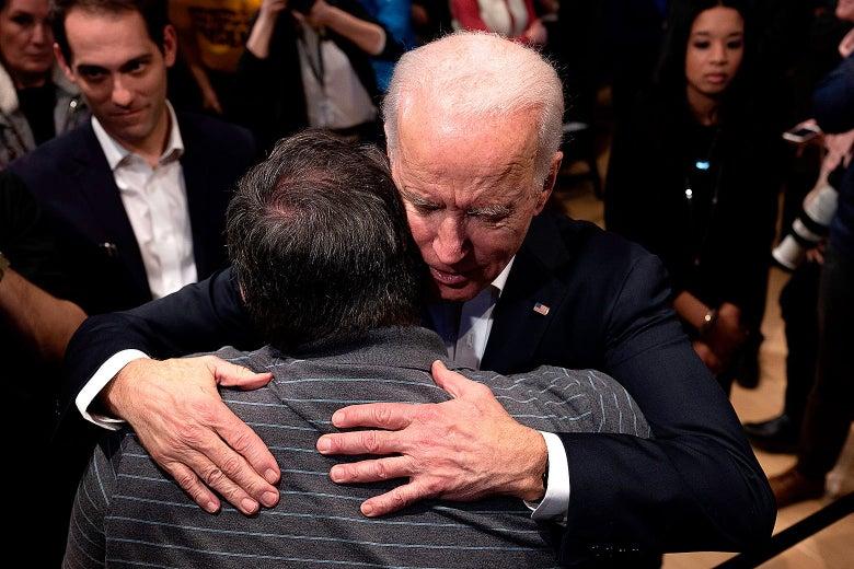 Joe Biden hugs a supporter during a town hall meeting in Newton, Iowa, on January 30, 2020.