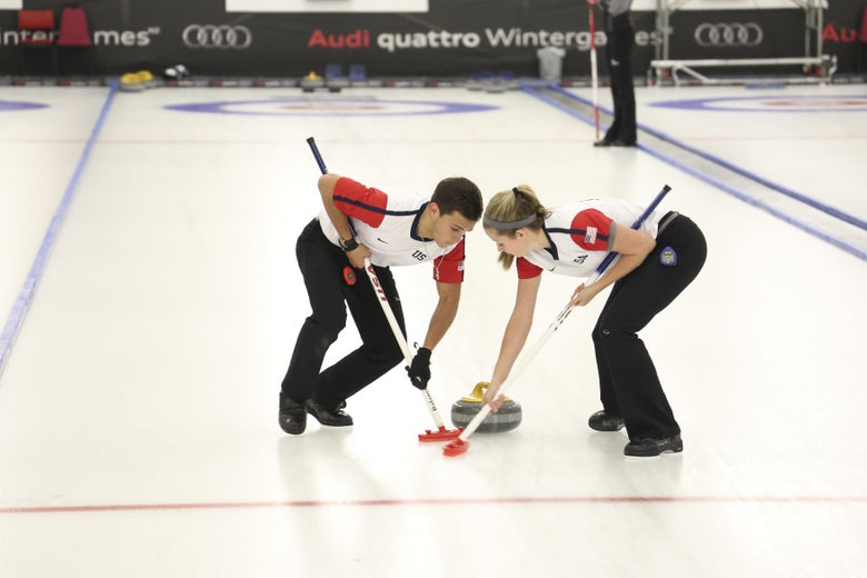 NASEBY, NEW ZEALAND - AUGUST 27:  Sarah Anderson & Korey Dropkin of USA working hard on their brooms in the Curling Mixed Doubles Finals during the Winter Games NZ at Naseby Curling Rink on August 27, 2015 in Naseby, New Zealand.  (Photo by Neil Kerr/Getty Images)