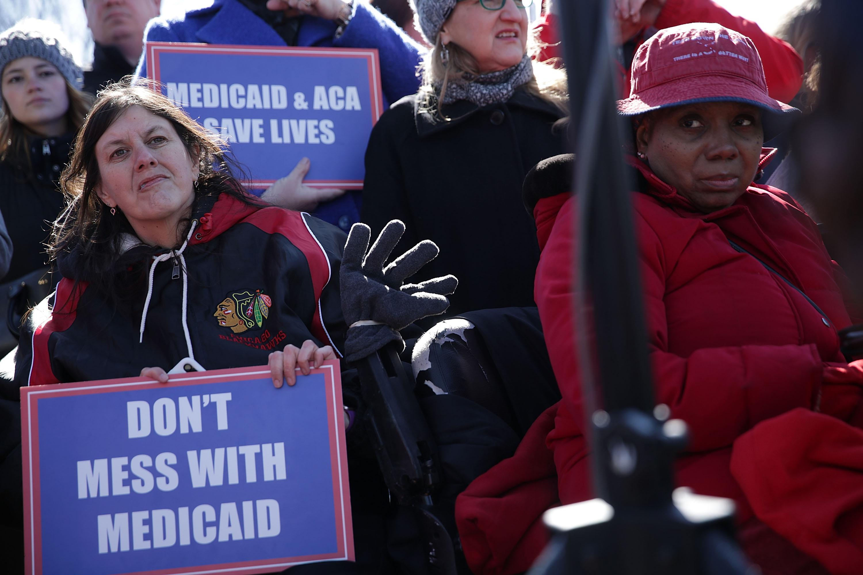WASHINGTON, DC - MARCH 22:  Health care activists participate in a rally in front of the Capitol March 22, 2017 on Capitol Hill in Washington, DC. Senate Democrats held the rally to highlight changes being sought in Medicaid in the Republican American Health Care Act.  (Photo by Alex Wong/Getty Images)