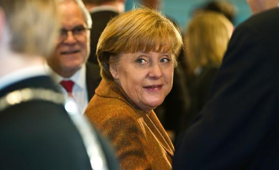 German Chancellor Angela Merkel arrives to greet participants at the start of a summit on the integration of foreigners in Germany, at the Chancellery on Jan. 31, 2012, in Berlin.
