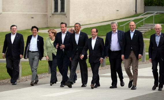 From left: President of the European Commission Jose Manuel Barroso, Japanese Prime Minister Shinzo Abe, German Chancellor Angela Merkel, Russia's President Vladimir Putin (walking behind), Britain's Prime Minister David Cameron, U.S. President Barack Obama, French President Francois Hollande, Canadian Prime Minister Stephen Harper, Italian Prime Minister Enrico Letta, and European Council President Herman Van Rumpuy, arrive for the group photograph at the G8 venue of Lough Erne on June 18, 2013, in Enniskillen, Northern Ireland.