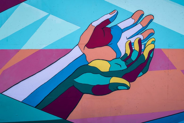 A mural of two brightly and surreally colored hands.
