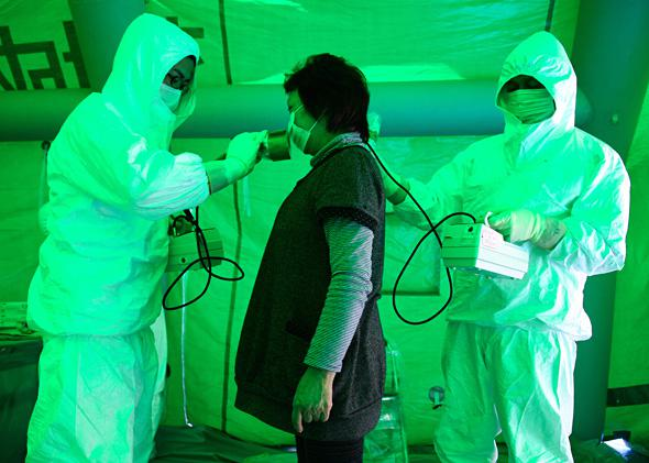 Geiger counter screening in Hitachi City, March 16, 2011.