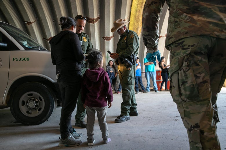 Families, mostly from Central America, wait to be transported to a U.S. Customs and Border Protection processing center after they crossed the Rio Grande from Mexico and presented themselves to border agents on September 10, 2019 in Los Ebanos, Texas.