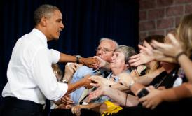 President Obama shakes hands with supporters as he arrives to address a campaign event at Truckee Meadows Community College in Reno, Nev., on Aug. 21, 2012