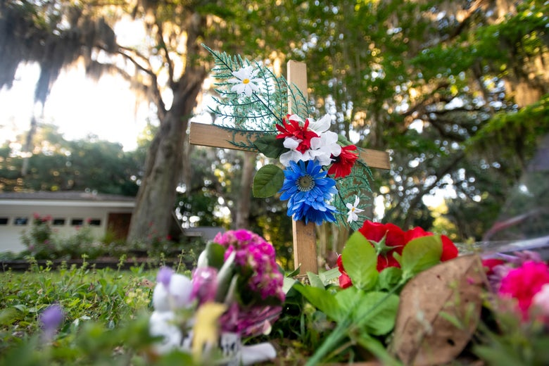 A commemorative cross with flowers in the Georgia neighborhood where Ahmaud Arbery was shot and killed.