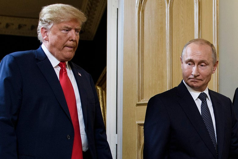 Donald Trump and Vladimir Putin stand beside each other.