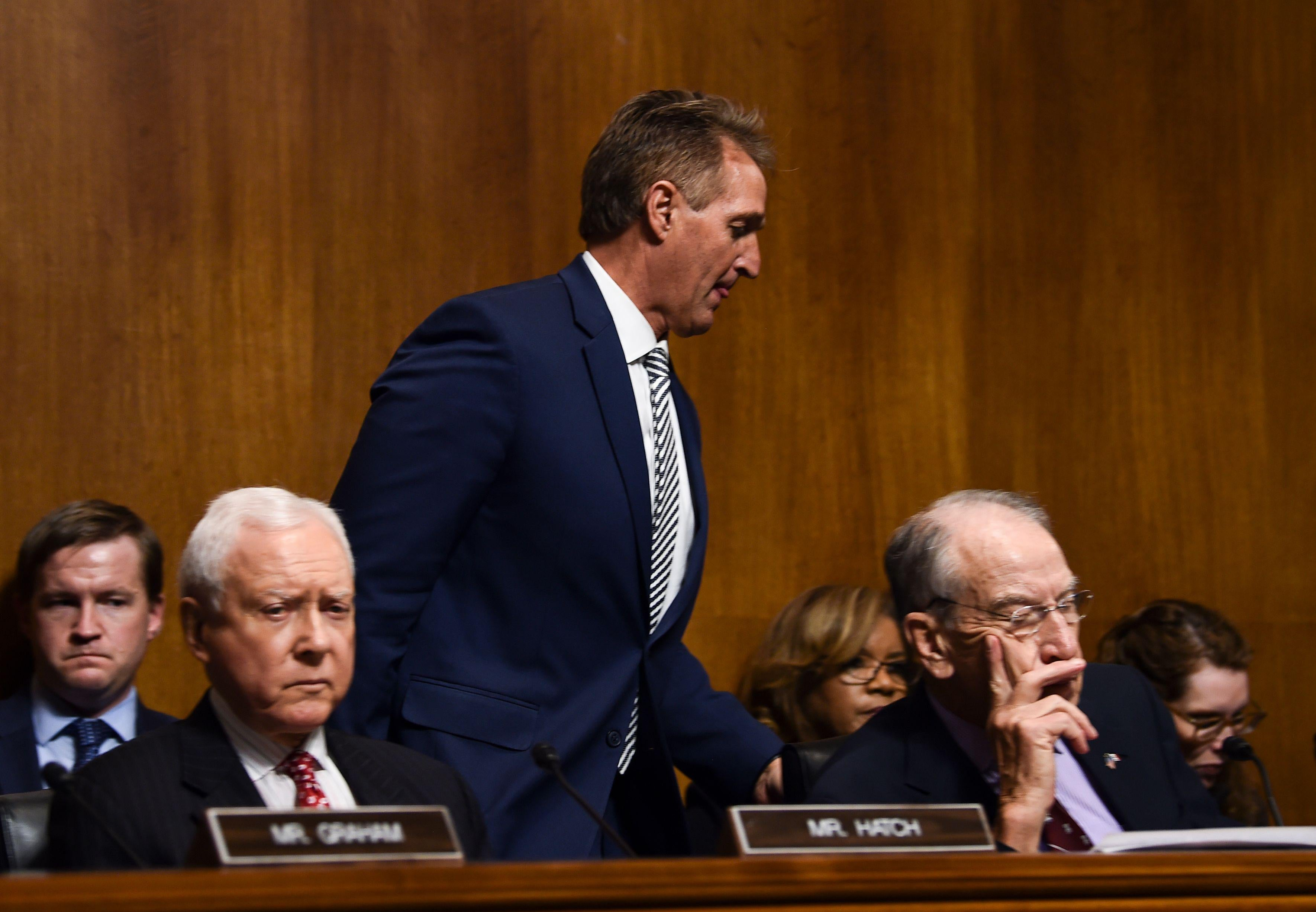 Jeff Flake walks out during a hearing on Brett Kavanaugh's nomination.
