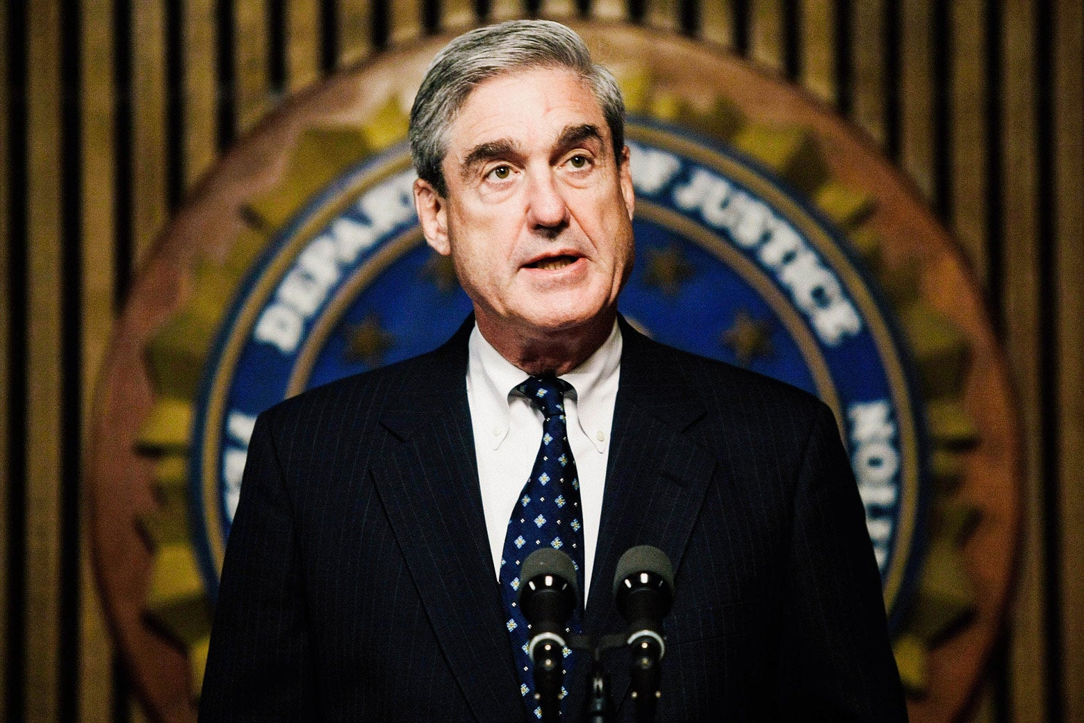 Robert Mueller speaks during a news conference at the FBI headquarters June 25, 2008