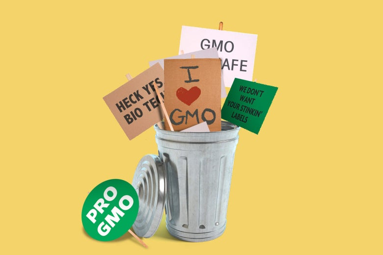 Pro-GMO signs are seen in a trash can.