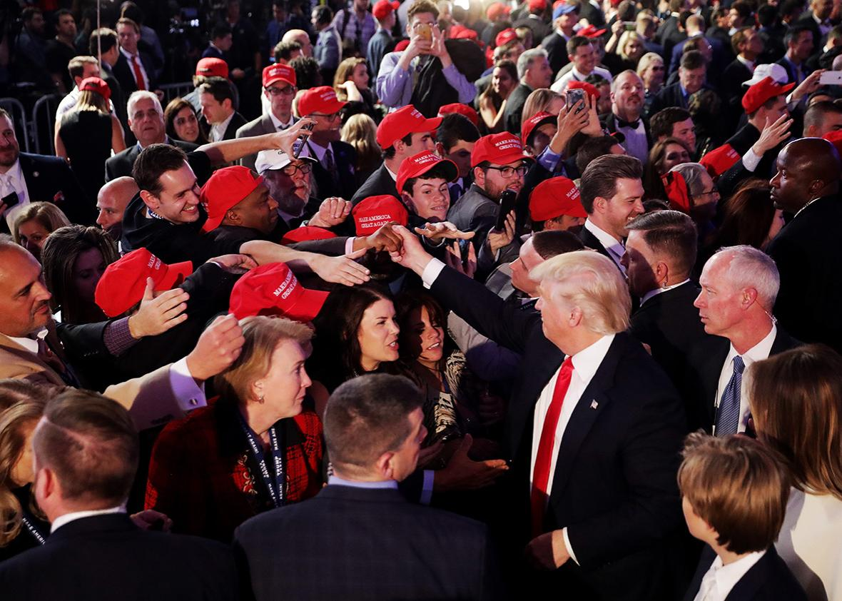 Republican president-elect Donald Trump gives greets people in the crowd after delivering his acceptance speech at the New York Hilton Midtown in the early morning hours of November 9, 2016 in New York City.
