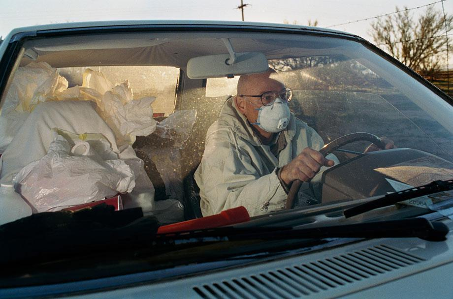 Thilde Jensen Canaries Randy in his car and home. Tucson, Ariz., 2005.