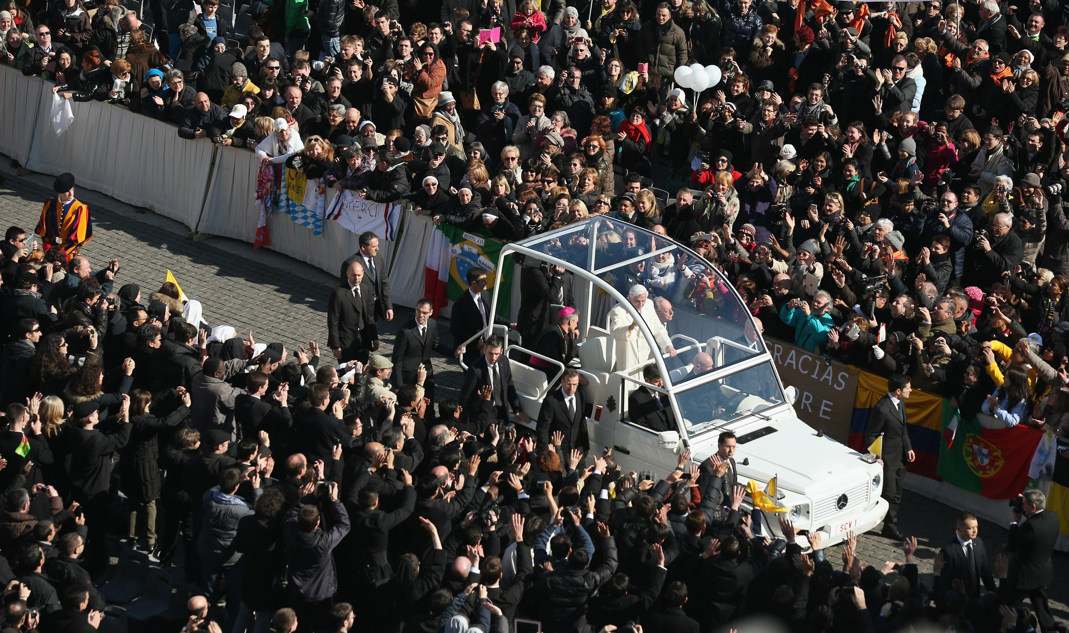 Pope Benedict XVI travels in the Popemobile through St. Peter's Square on Feb. 27, 2013, in Vatican City.