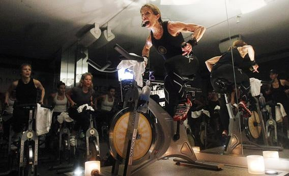 A fitness instructor leading a SoulCycle class.