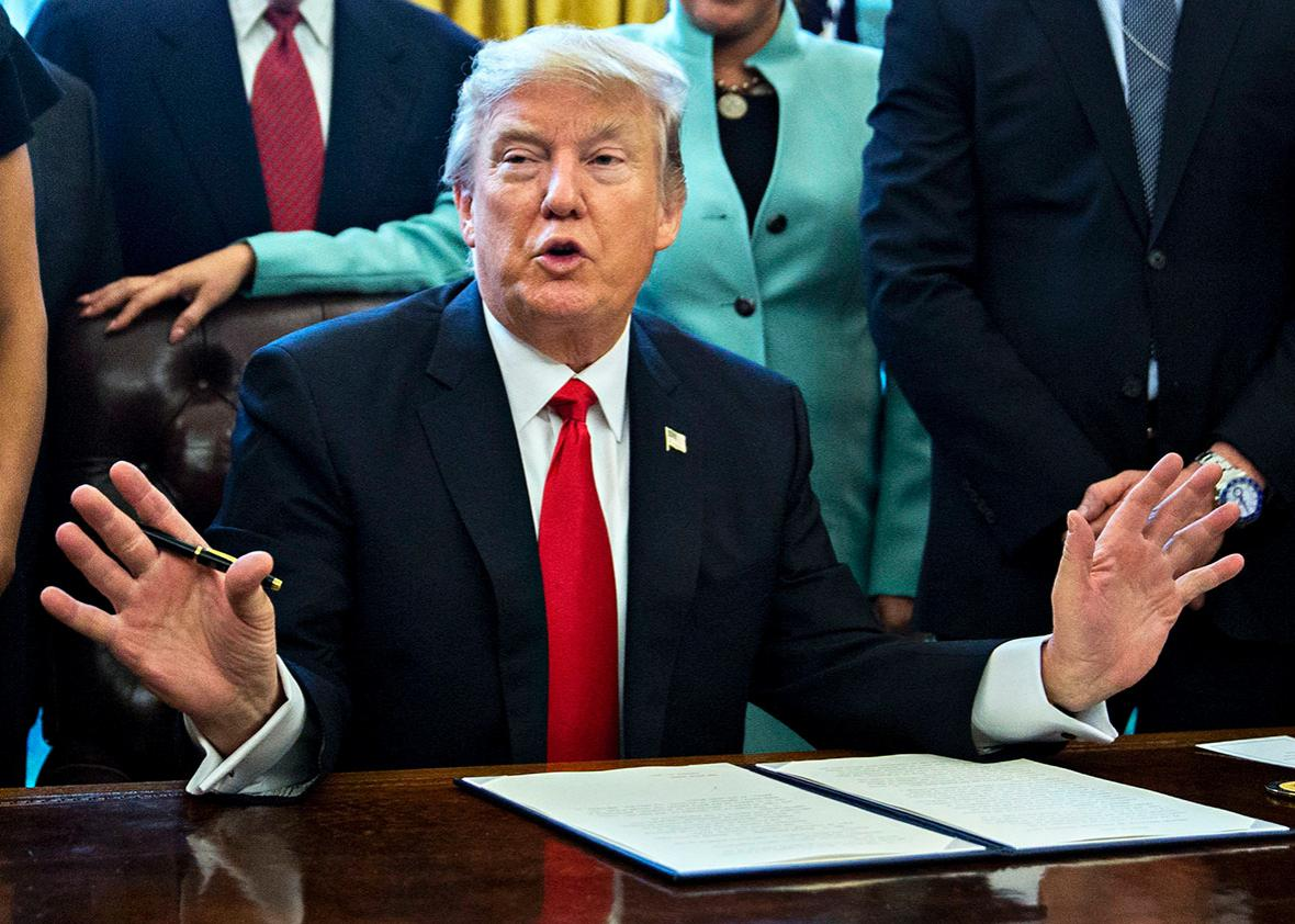 U.S. President Donald Trump speaks before signing an executive order surrounded by small business leaders in the Oval Office of the White House January 30, 2017 in Washington, DC.