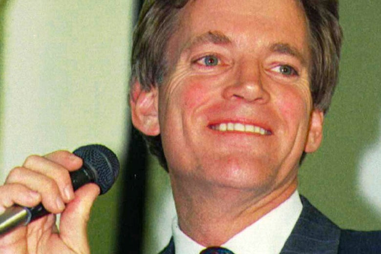 Close-up of David Duke smiling and holding a microphone.