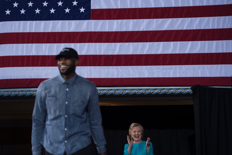 NBA basketball player Lebron James and Hillary Clinton arrive for a rally at the Cleveland Public Auditorium November 6, 2016 in Cleveland, Ohio.
