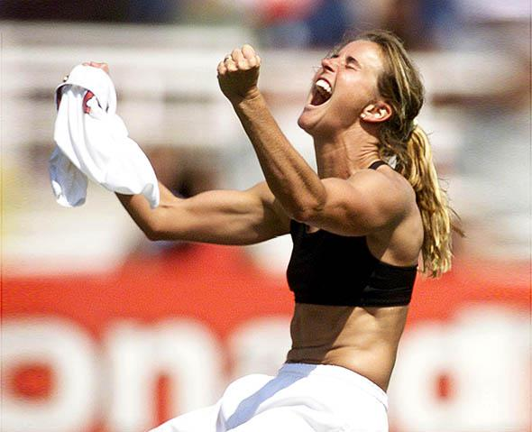 Brandi Chastain of the US celebrates after kicking the winning p