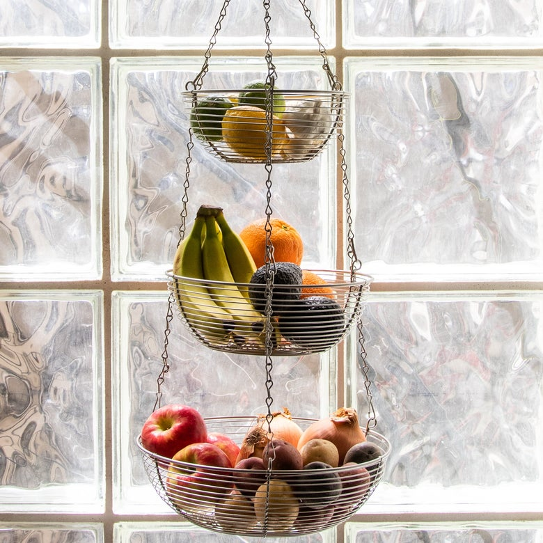 Sur la Table's Three-Tier Hanging Basket filled with fruit