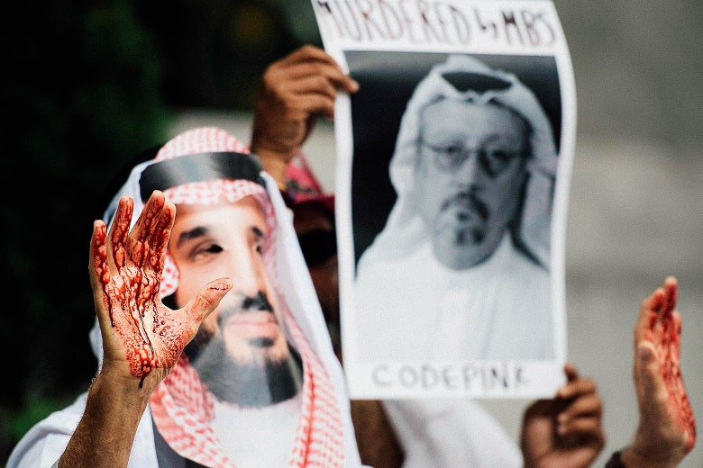 A demonstrator dressed as Saudi Arabian Crown Prince Mohammed Bin Salman with blood on his hands protests outside the Saudi Embassy in D.C.