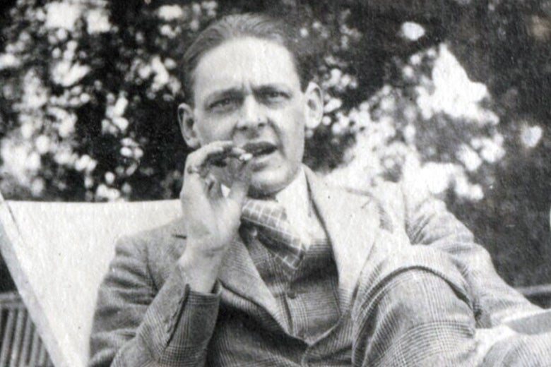 A black-and-white photo of T.S. Eliot smoking a cigar.