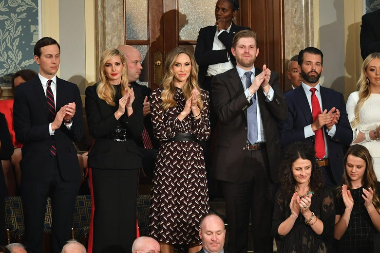 Jared Kushner, Ivanka Trump, Eric Trump, and Donald Trump, Jr., stand and applaud during a state of the union address.