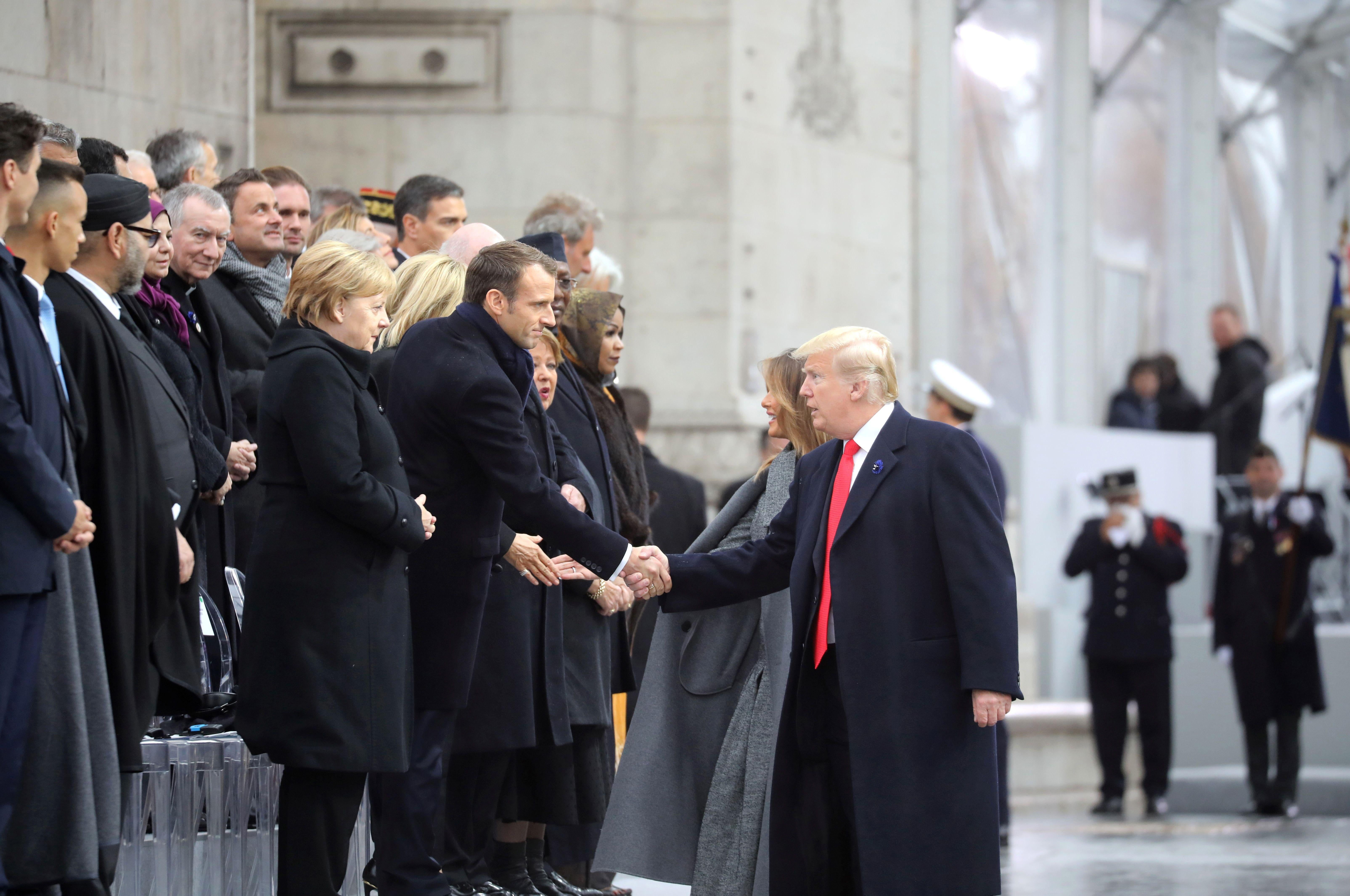 US president Donald Trump shakes hands with French president Emmanuel Macron as he arrives at the Arc de Triomphe in Paris on November 11, 2018 to attend a ceremony as part of commemorations marking the 100th anniversary of the 1918 armistice.