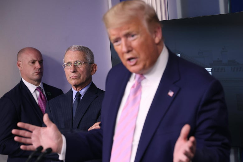 Anthony Fauci, director of the National Institute of Allergy and Infectious Diseases, listens to President Donald Trump speak from the press briefing room with members of the White House Coronavirus Task Force on April 1, 2020 in Washington, D.C.