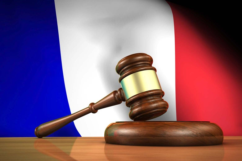 A gavel in front of the French flag.