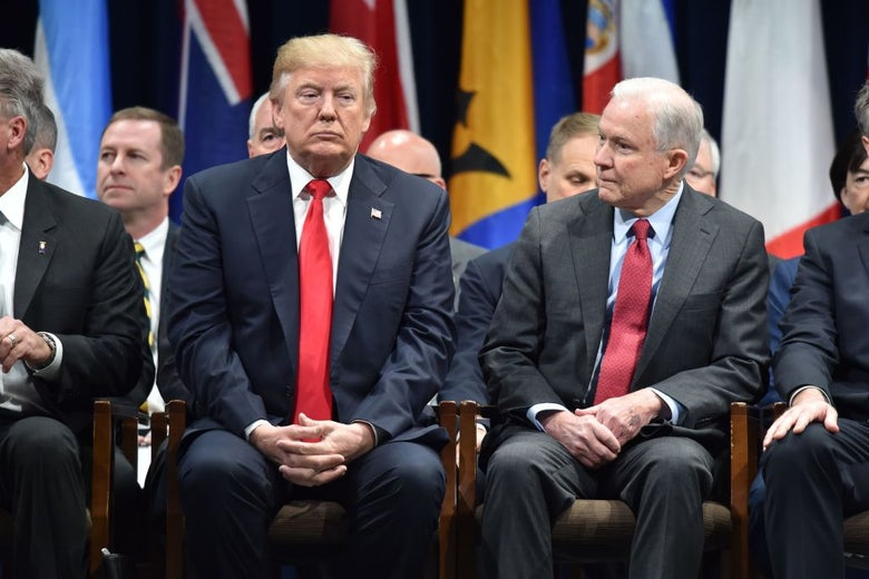 Donald Trump and attorney general Jeff Sessions on Dec. 15, 2017 in Quantico, Virginia at the FBI National Academy graduation ceremony.