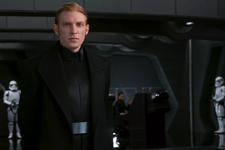 General Hux stands on the bridge of his star destroyer.