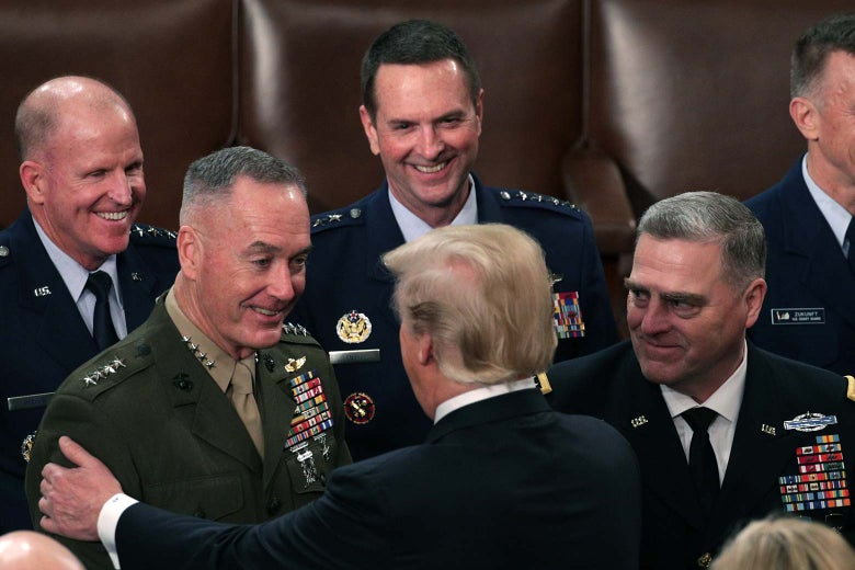 Trump greeting Dunford and other military officials.