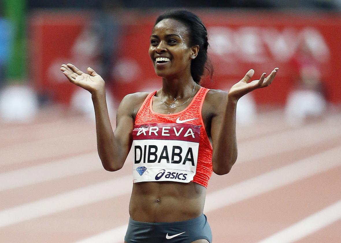 Ethiopia's Genzebe Dibaba celebrates after winning the women's 5000m during the IAAF Diamond League athletics meeting at the Stade de France in Saint-Denis, outside Paris, on July 4, 2015.