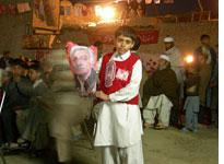 A young ANP supporter with an Asfandyar Wali Khan poster          Click image to expand.