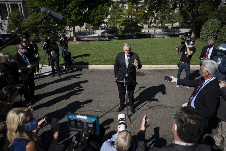 Mark Meadows surrounded by reporters and photographers