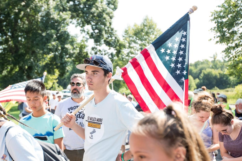 Activists including Parkland Shooting survivor and activist David Hogg gather before the final mile of the 50 Miles More walk against gun violence which ends with a rally at the Smith and Wesson Firearms factory on August 26, 2018 in Springfield, Massachusetts.