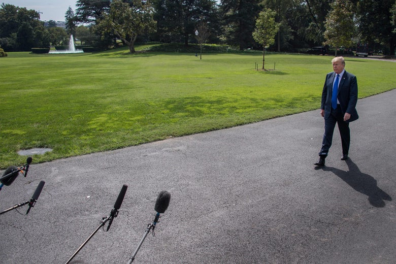 President Donald Trump approaching microphones at the White House on Tuesday.