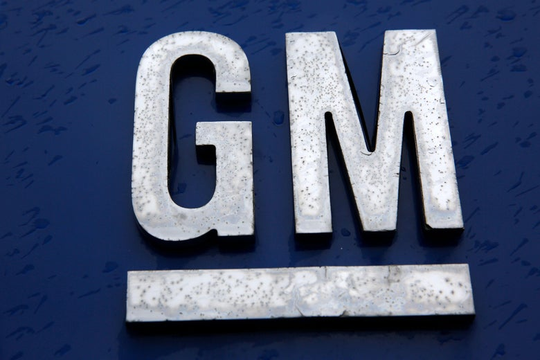 A blue sign with the GM logo.