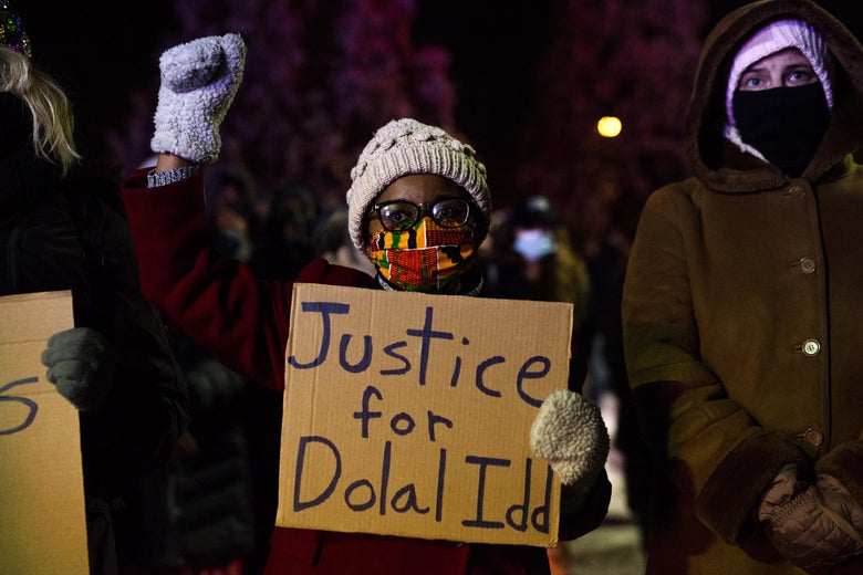 People gather at Holiday gas station where Dolal Idd was shot and killed by Minneapolis Police for a vigil on December 31, 2020 in Minneapolis, Minnesota.