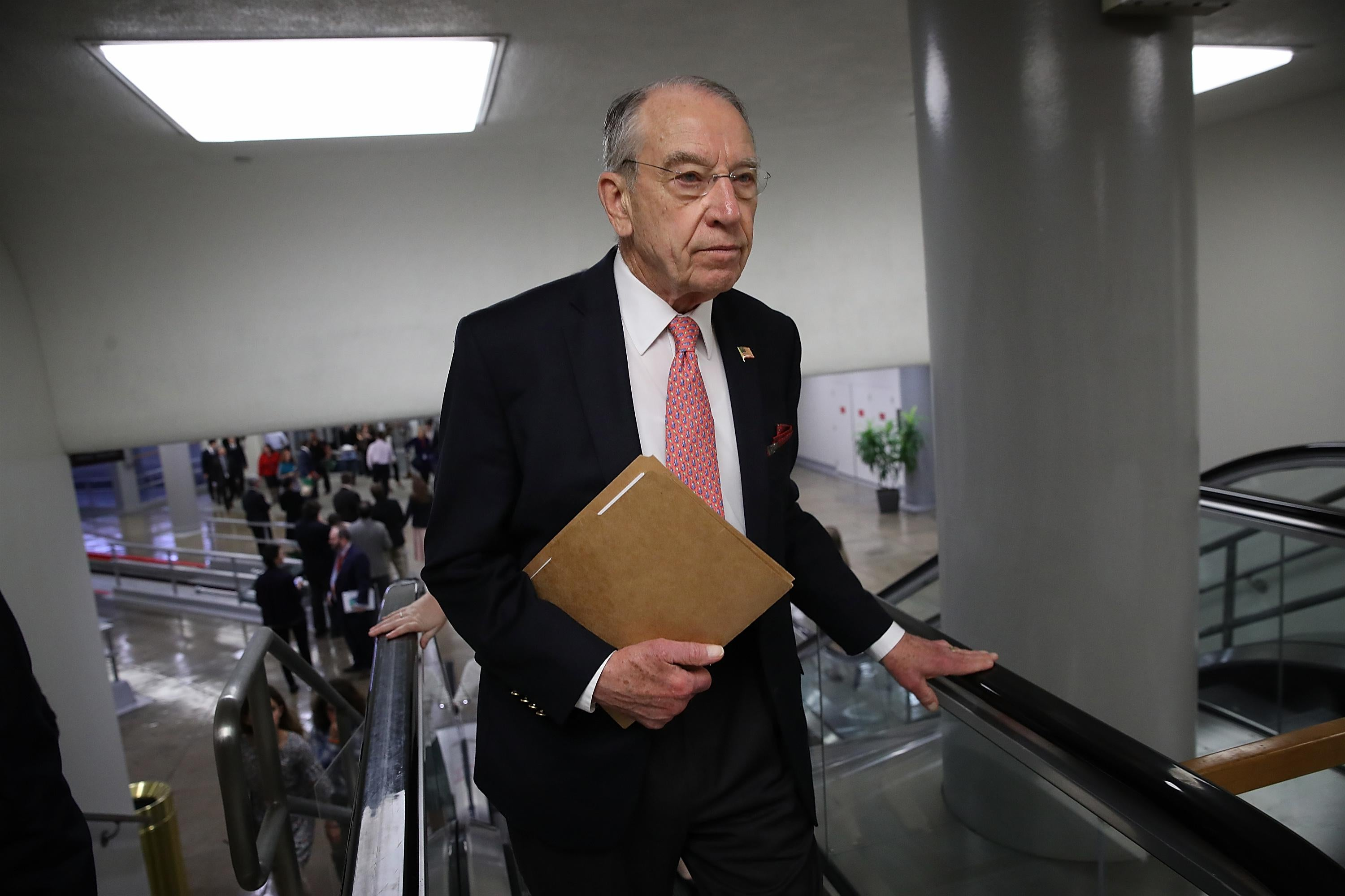 Chuck Grassley walks to the Senate chamber for a vote after the Judiciary Committee voted 14-7 to advance legislation designed to protect special counsel Robert Mueller's investigation.