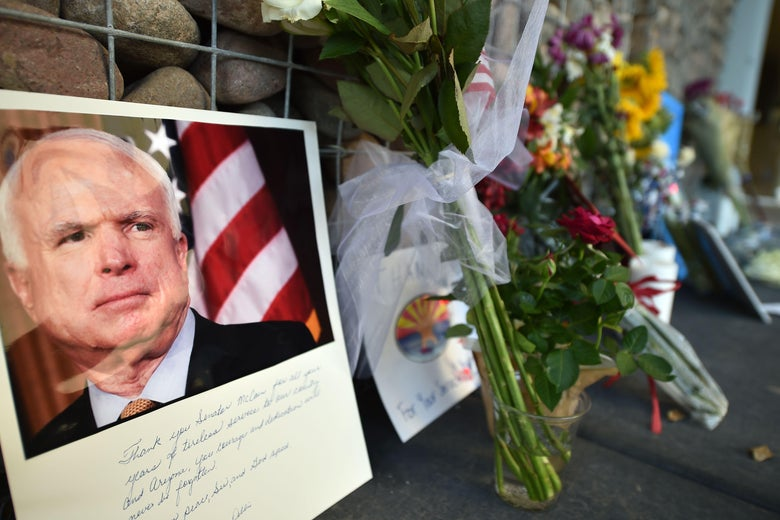 A memorial of flowers, notes, and photographs outside John McCain's Phoenix office.
