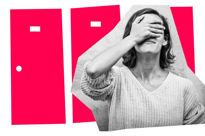 Woman covering her face with embarrassment in front of two pink apartment doors.