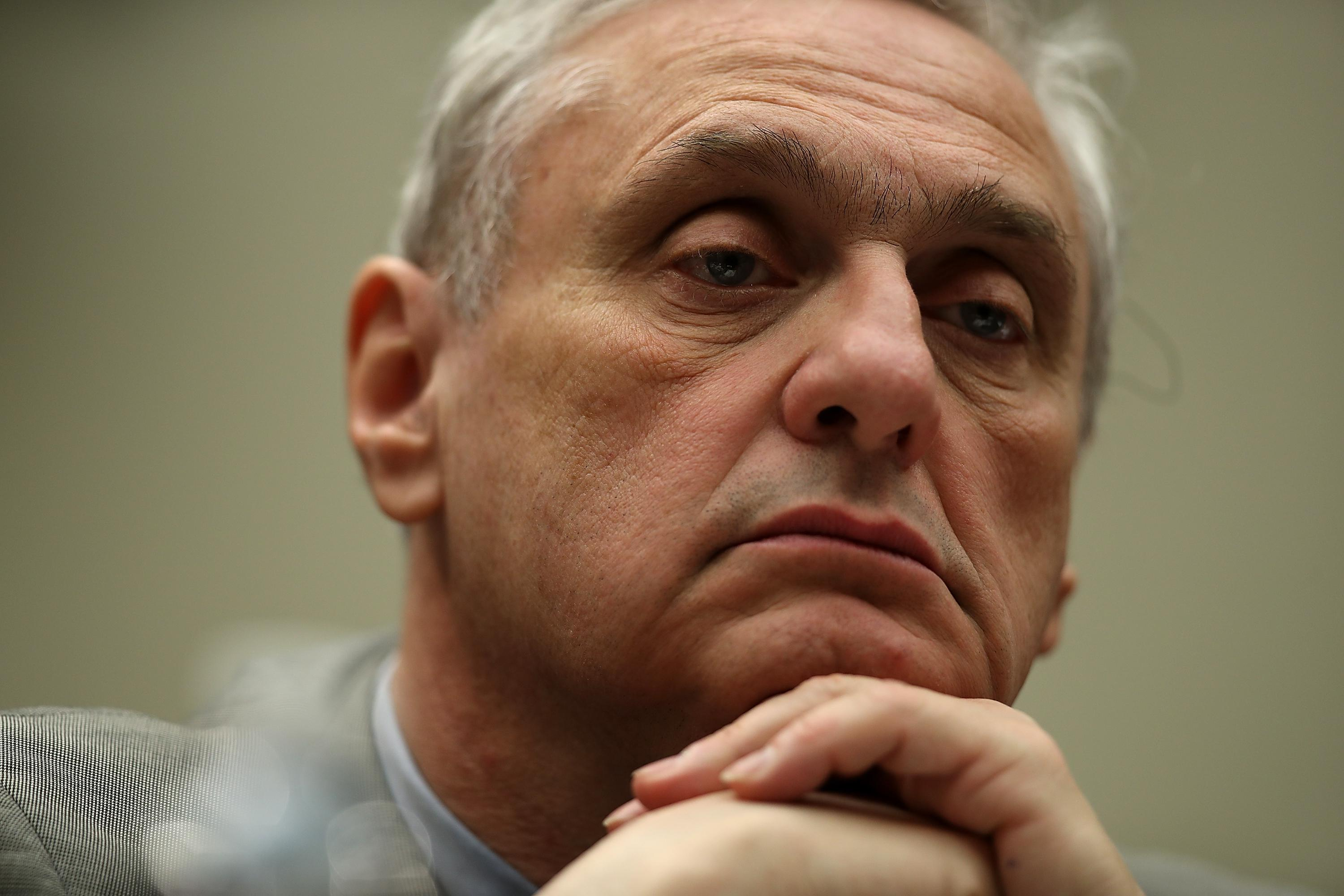 Ninth Circuit Appeals Court Chief Judge Alex Kozinski looks on with his hands on his chin during a House Judiciary Committee hearing.