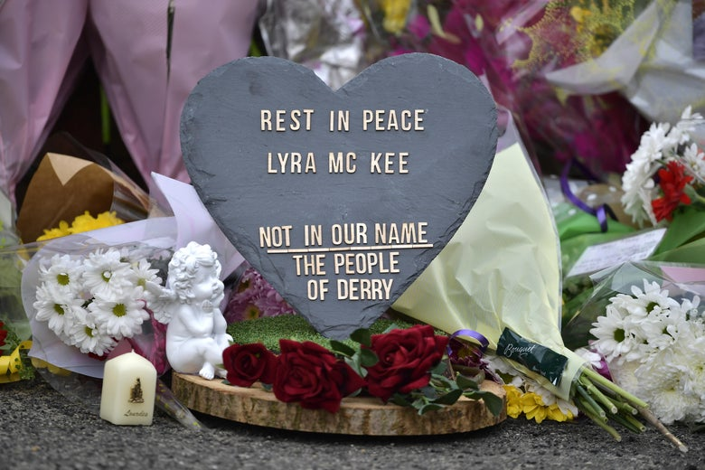 A plaque and flowers are left in tribute to journalist Lyra McKee near the scene of her shooting on April 19, 2019 in Londonderry, Northern Ireland.
